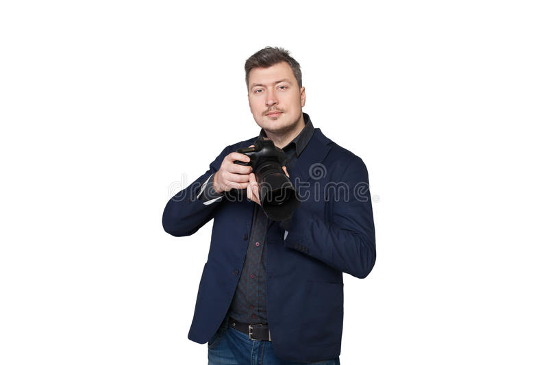 Portrait of cameraman with digital photo camera. Portrait of professional cameraman with digital photo camera, front view, white background royalty free stock image