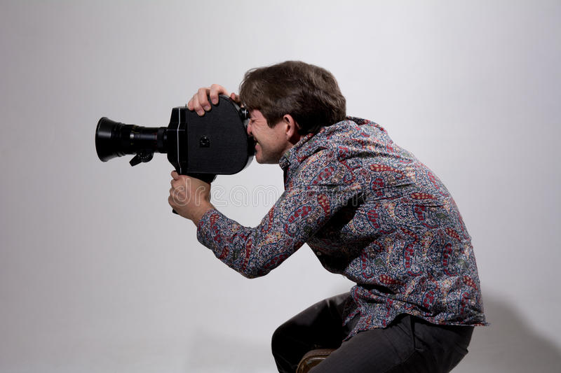 Portrait of cameraman with old movie camera.  stock photo