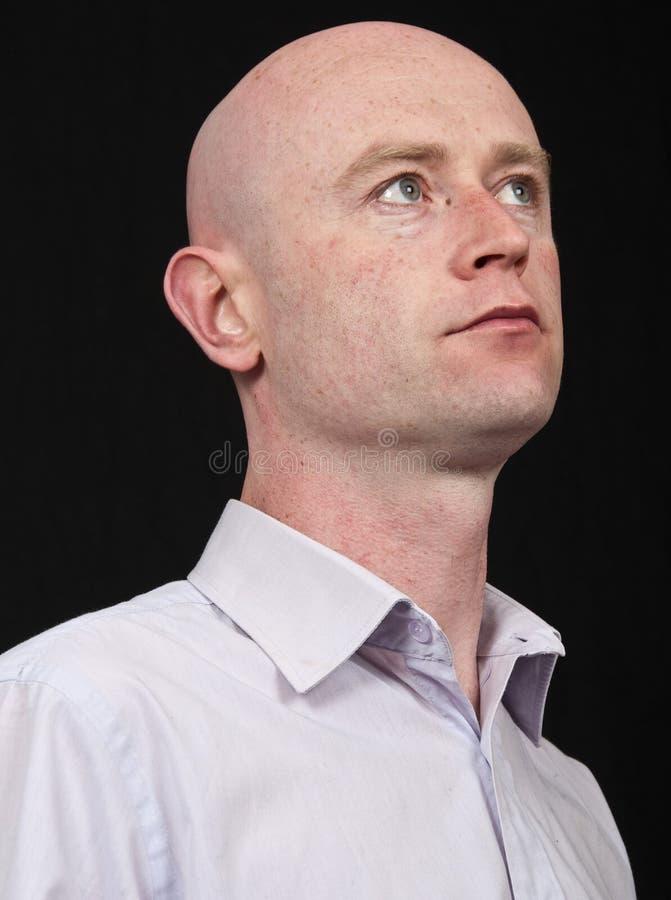 Portrait capture 30's male on black backdrop stock photos