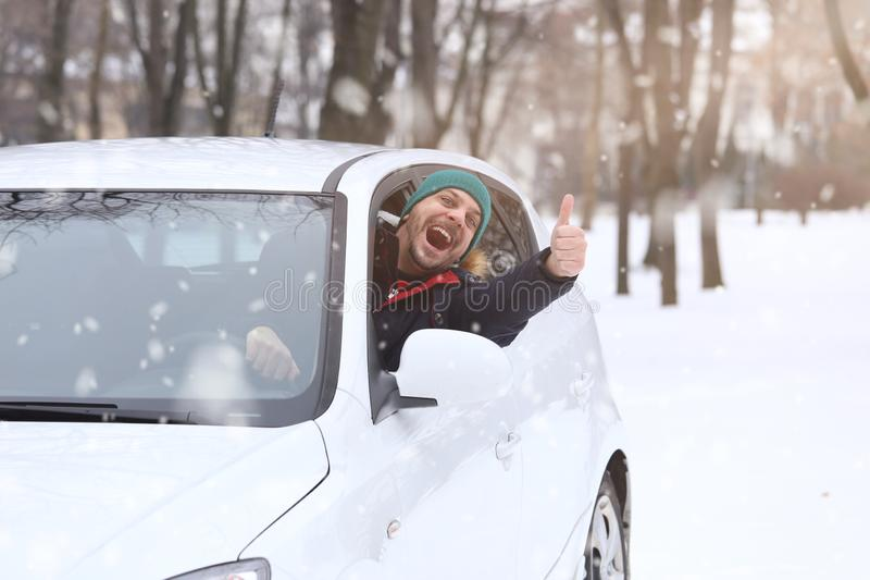 Portrait of car driver with smile santa hat and thumb up throug royalty free stock photos
