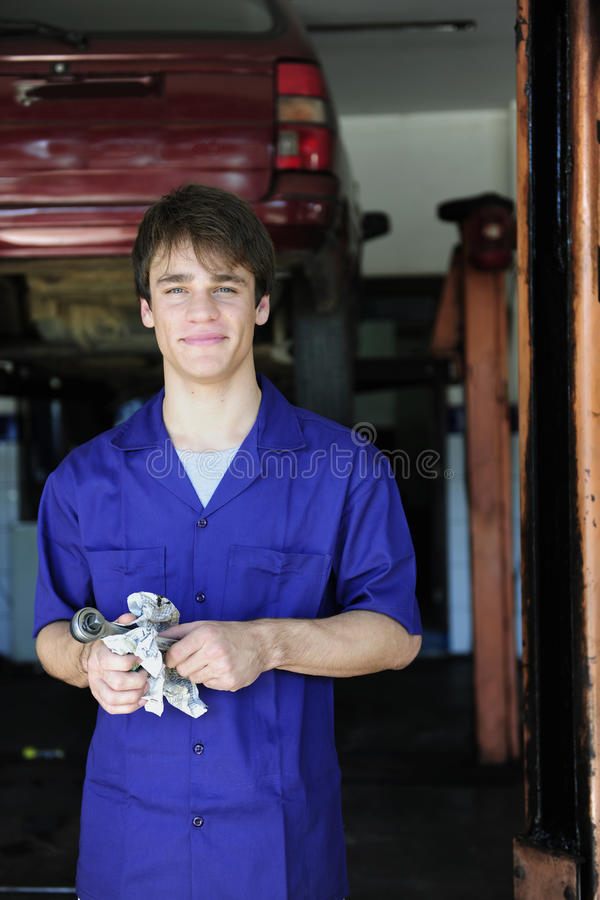 Portrait Of A Car Mechanic At Work Royalty Free Stock Image