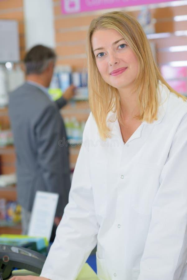Portrait cashier posing. Portrait of a cashier posing stock photos
