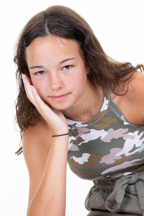 Portrait of casual beauty young woman teenager girl fashion army camouflage T-shirt on white background. A Portrait of casual beauty young woman teenager girl royalty free stock photo
