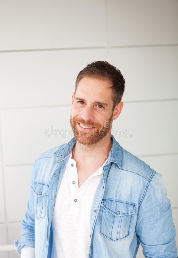 Portrait of a casual guy with denim shirt. In the street stock photography