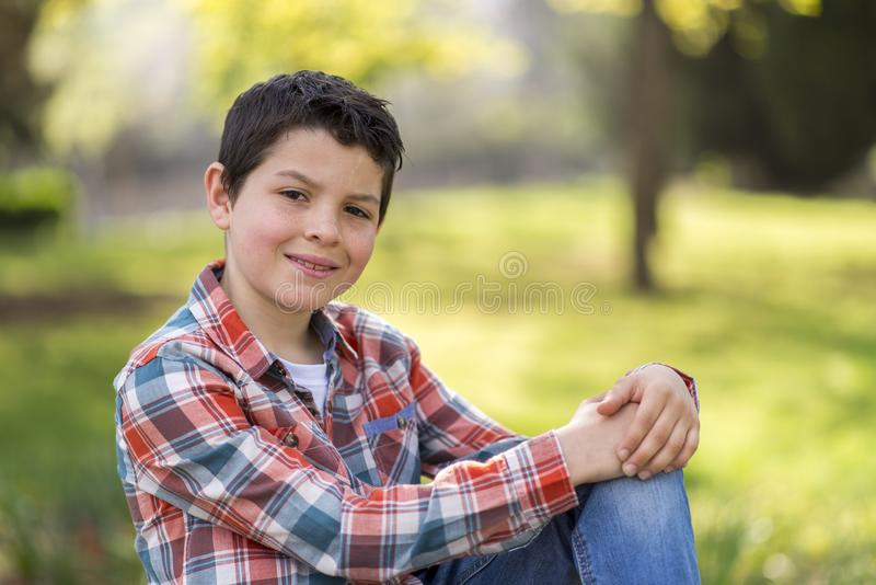 Portrait of a casual teen boy, outdoors stock photo