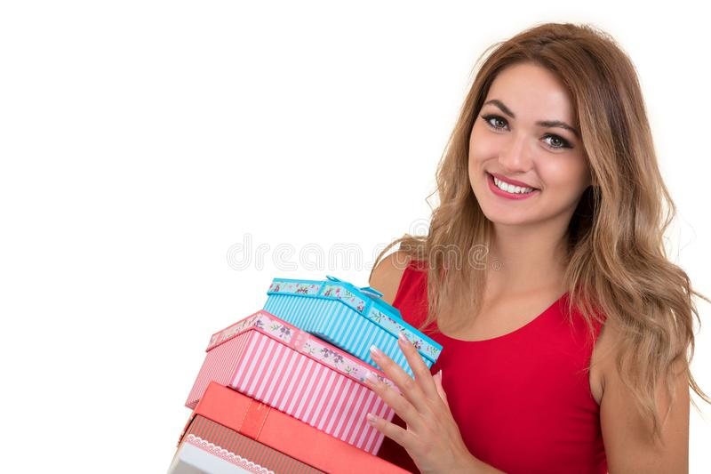 Portrait of casual young happy smiling woman hold red gift box. Isolated studio background female model. royalty free stock images