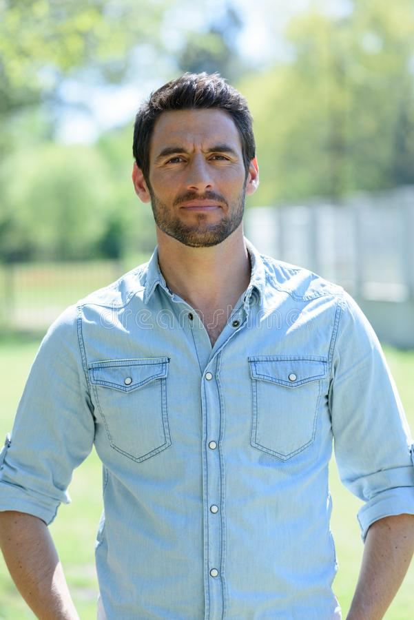 Portrait casually dressed handsome man standing outdoors stock photography