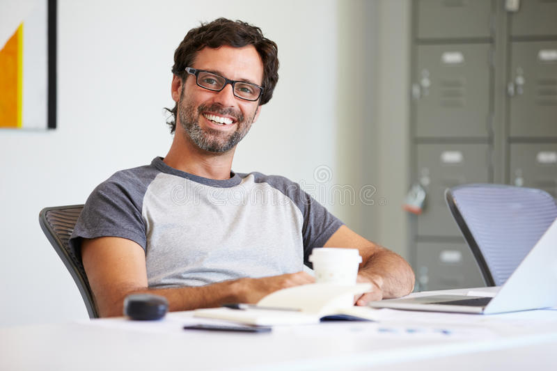 Portrait Of Casually Dressed Man Working In Design Studio stock images