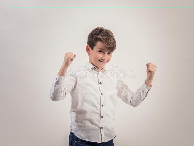 Portrait caucasian boy on grey background,Strong,Proud. Portrait caucasian boy on grey background,Strong and Proud royalty free stock image