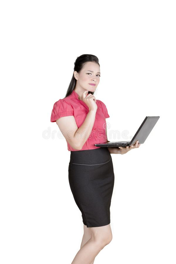 Pensive businesswoman with a laptop on studio stock images