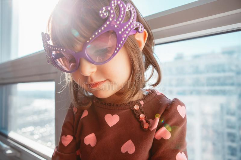 Portrait of Caucasian girl chil with funny glasses stock photos