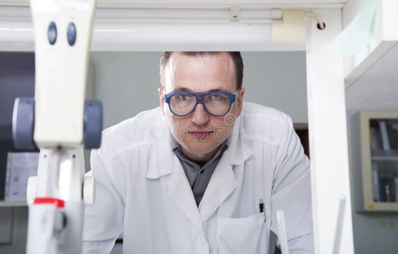 Portrait of caucasian male chemist scientific researcher in laboratory stock images