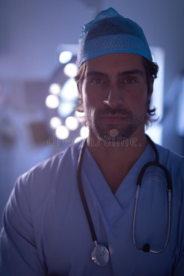 Male surgeon standing in operation room at hospital stock images