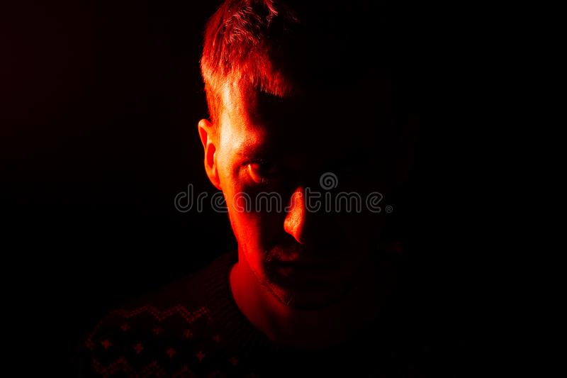 A portrait of a Caucasian man whose half of the head is hidden i royalty free stock photo