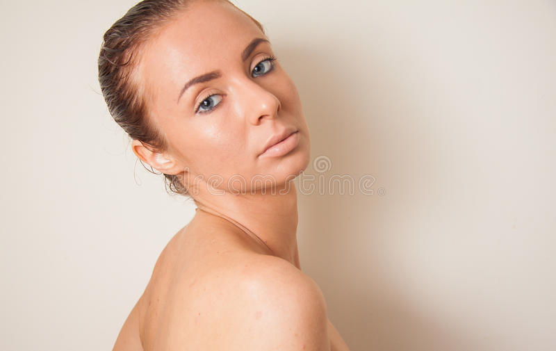 Portrait of caucasian model with naked shoulders and nude makeup royalty free stock photos