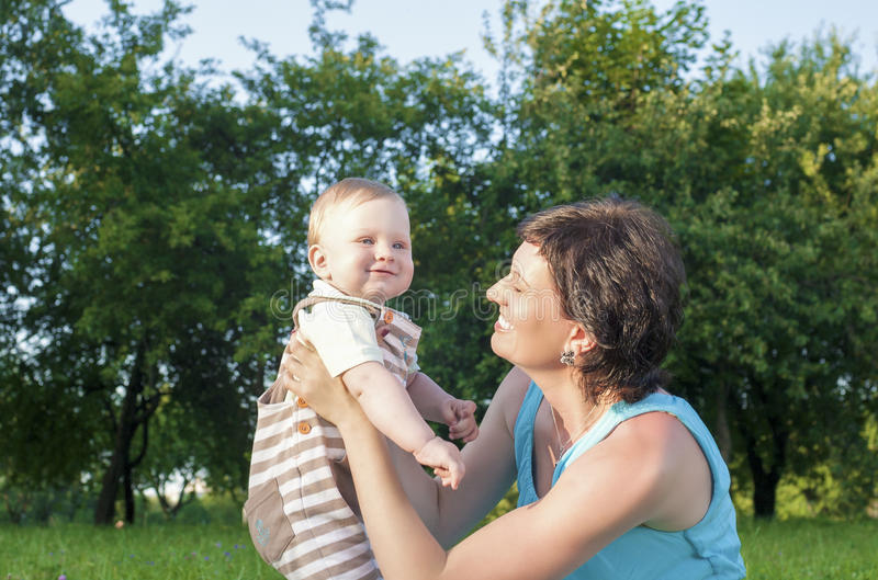 Portrait of Caucasian Mother with Her Little Son Spending Time Together. Outdoors in Park.Horizontal Image stock image