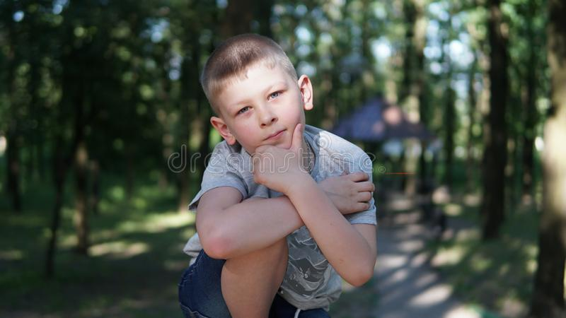 Portrait of caucasian teen boy. Funny cute teenager in summer park at day. Close up portrait of caucasian teen boy. Funny cute teenager in summer park at day royalty free stock photo