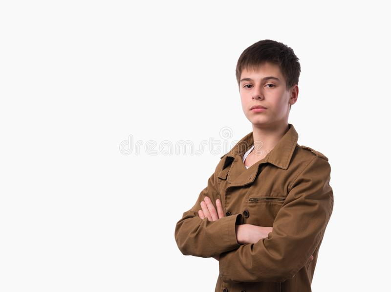 Portrait of caucasian teen boy on white background with folded arms. Handsome child looking at camera stock photos