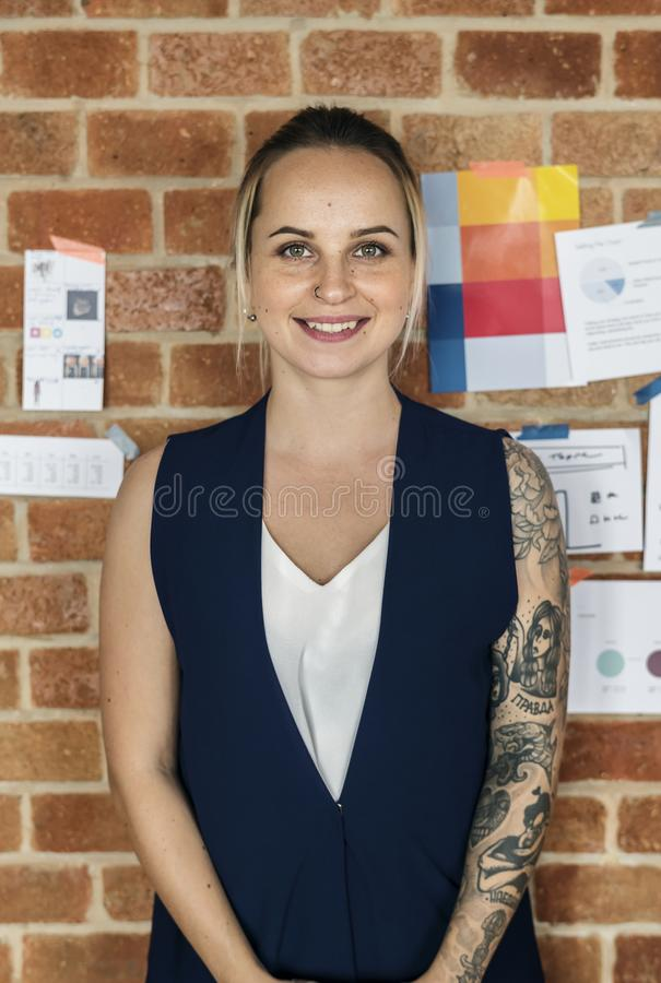 Portrait of Caucasian woman against brick wall stock images