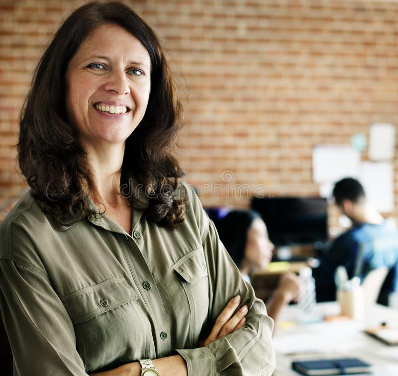 Portrait of caucasian woman in office stock images