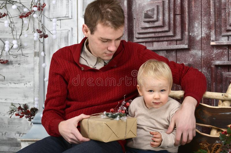 Portrait of caucasin father surprising his little son with Chris royalty free stock images