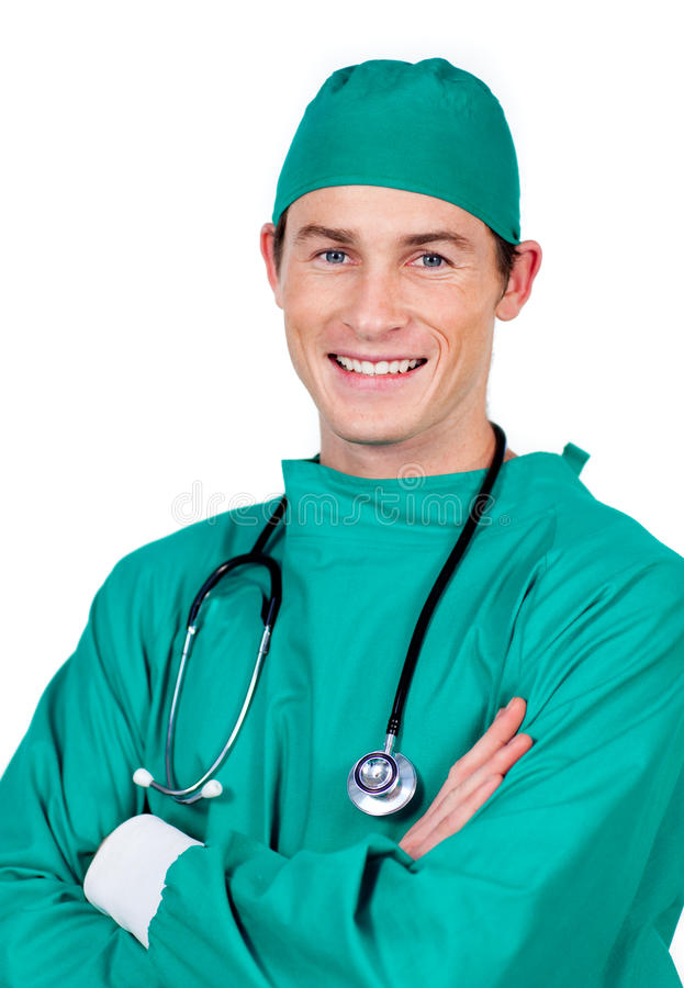 Portrait of a charismatic surgeon with folded arms. Against a white background royalty free stock photos