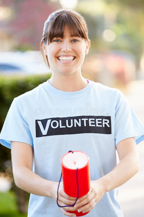 Portrait Of Charity Volunteer On Street With Collection Tin. Smiling To Camera stock photography