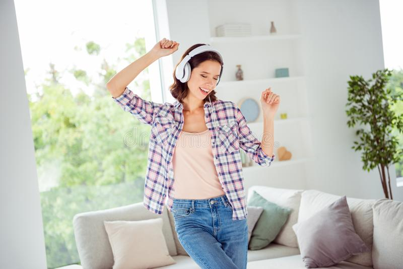 Portrait charming attractive lady teen teenager soundtrack hit melody rejoice content positive cheerful wavy curly. Hairdo stylish trendy plaid clothing shirt royalty free stock photography