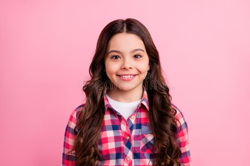 Portrait of charming attractive lovely kid little lady feel candid optimistic wear checkered modern fashionable clothing stock photography