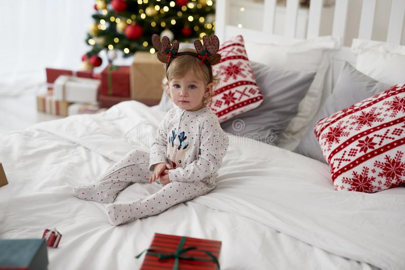Charming baby in Christmas morning stock photo
