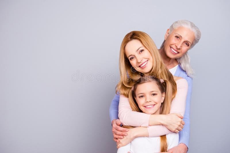 Portrait of charming beautiful friendly king supportive cute family members hugging each other isolated on gray background royalty free stock photos