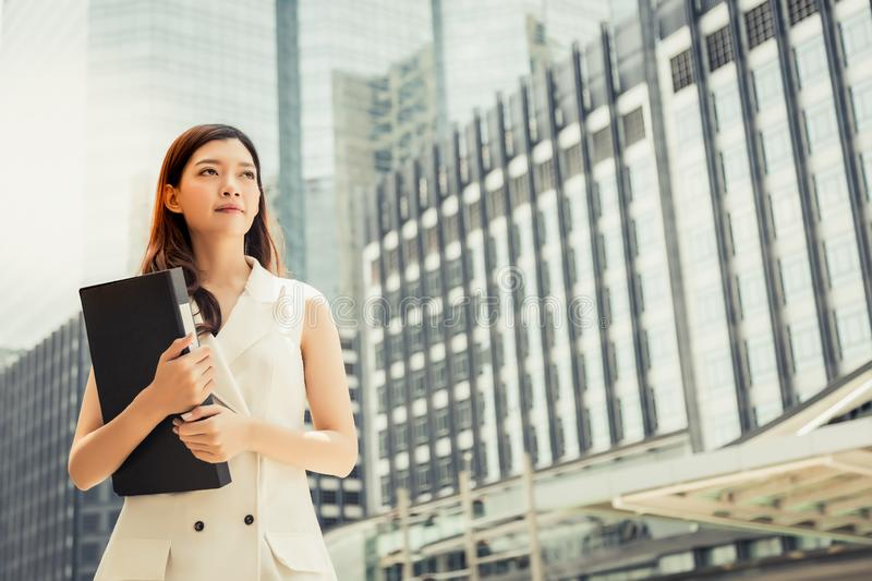 Portrait charming beautiful secretary woman. Attractive beautiful woman hold document file at street near her office. Gorgeous gi stock photo