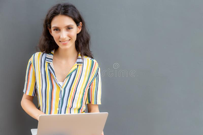 Portrait charming beautiful white collar woman or business woman. Attractive beautiful working woman holding laptop computer and l royalty free stock image