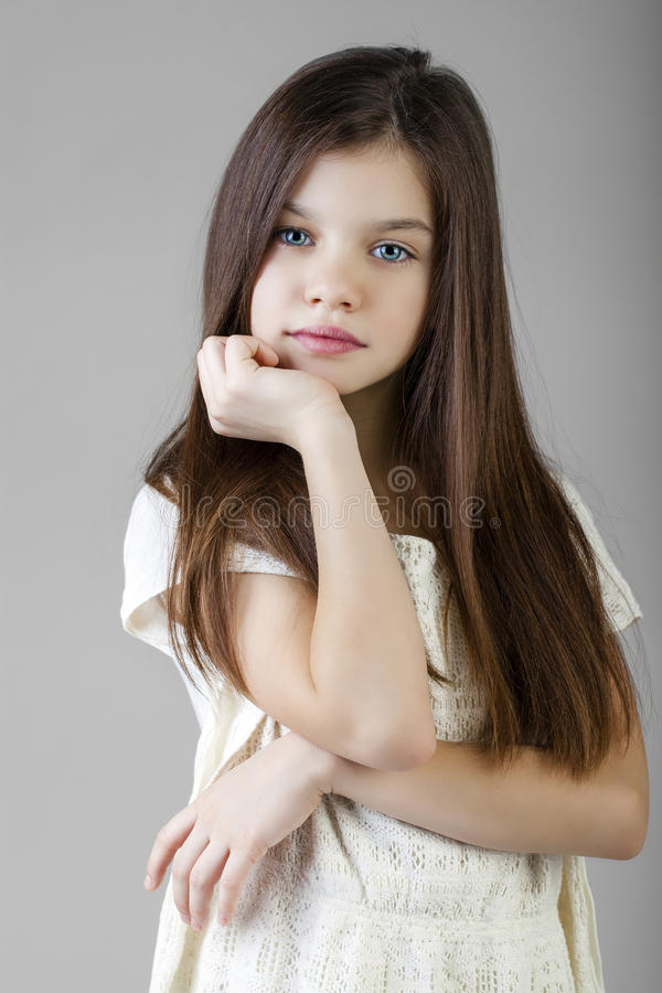 Portrait of a charming brunette little girl royalty free stock image