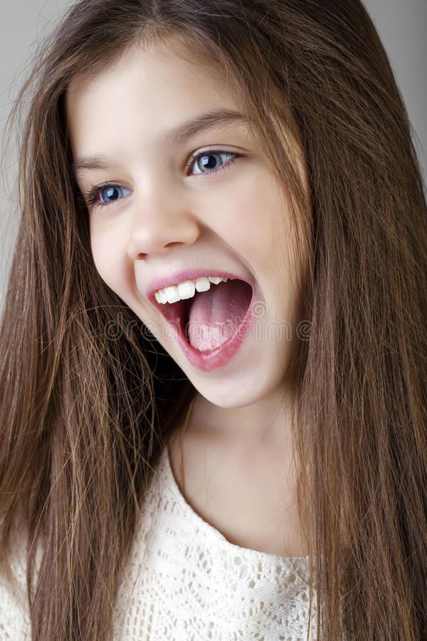Portrait of a charming brunette little girl royalty free stock photography