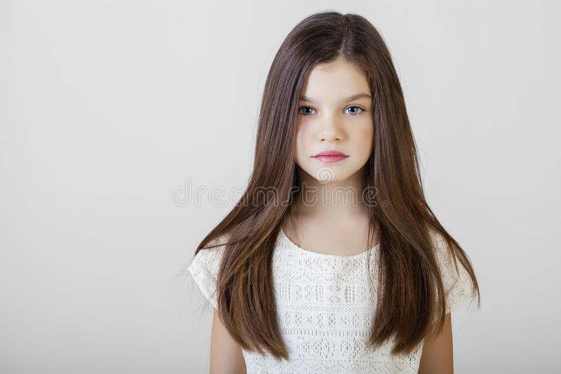 Portrait of a charming brunette little girl stock image