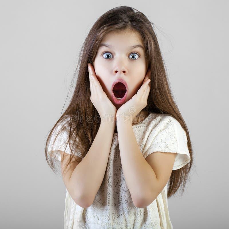Portrait of a charming brunette little girl stock photo