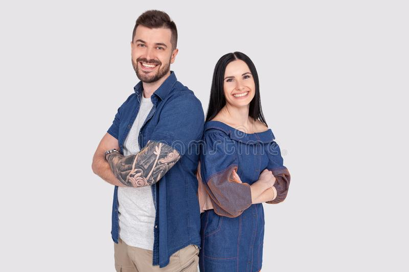 Portrait of charming charismatic freelancers entrepreneurs ready to solve business work problems take decisions. Wearing jeans stock photography
