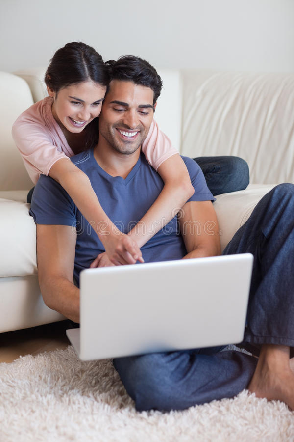 Portrait Of A Charming Couple Using A Laptop Stock Image