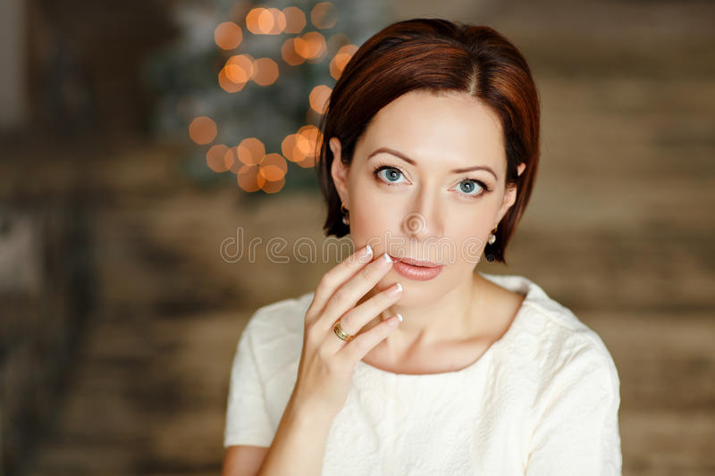 Portrait of charming dark-haired sensual girl with short hair in royalty free stock image