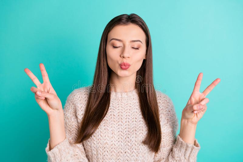 Portrait of charming dreamy peaceful girl make v-signs send air kisses date with her sweetheart wear woolen white. Portrait of charming dreamy peaceful girl make stock photography