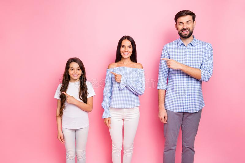 Portrait of charming family with long haircut wear white t-shirt checkered plaid shirt blouse point at copy space stock images
