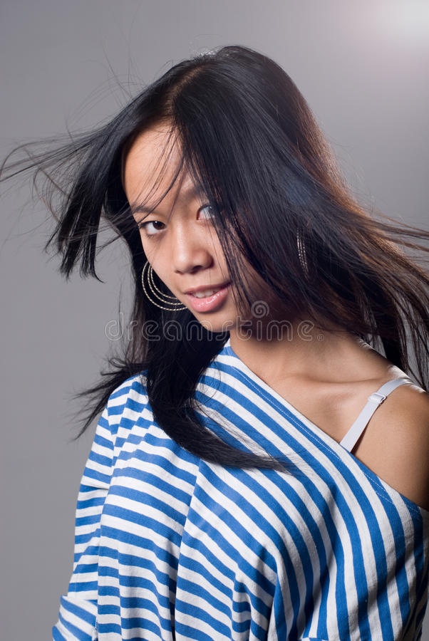 Portrait Of Charming Girl With A Flying Hair Stock Photo