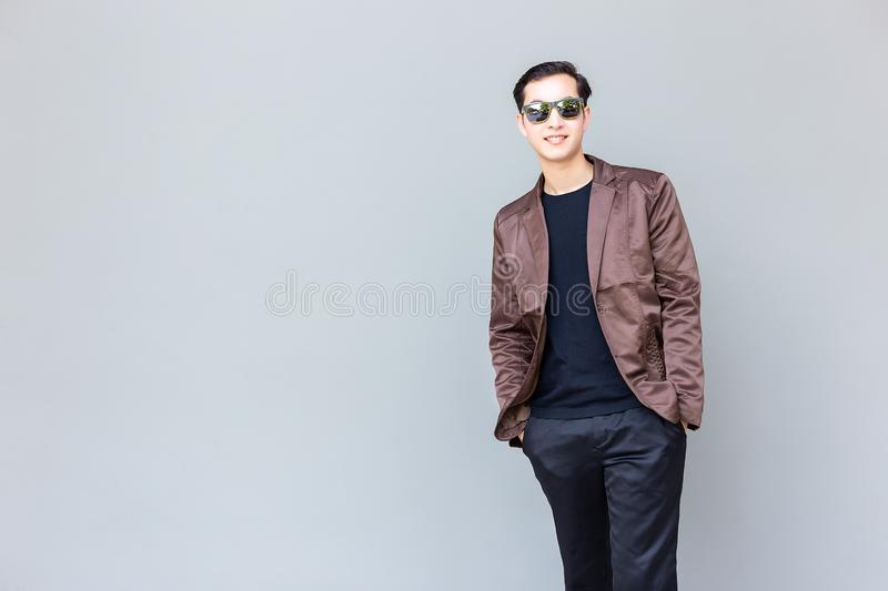 Portrait charming handsome businessman. Attractive handsome guy. Look smart, relaxed. Cool guy look confident. He love wearing sunglasses, leather jacket, long royalty free stock photo