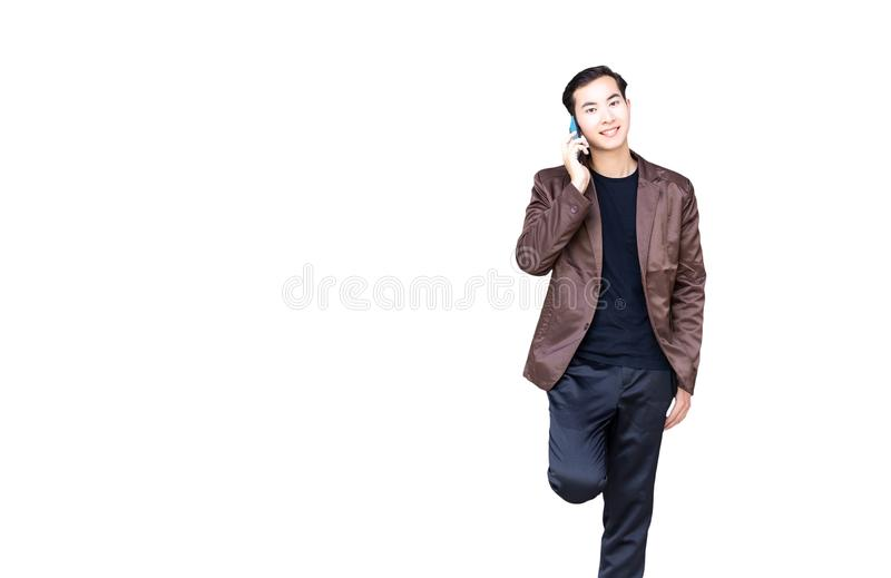 Portrait charming handsome young businessman. Attractive business guy talks to customer by using mobile phone. Good looking man g stock image