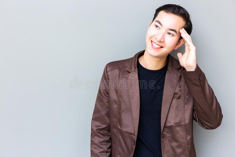 Portrait charming handsome young businessman. Attractive handsome guy is looking at copy space. Cool guy feel happy, satisfied so royalty free stock images