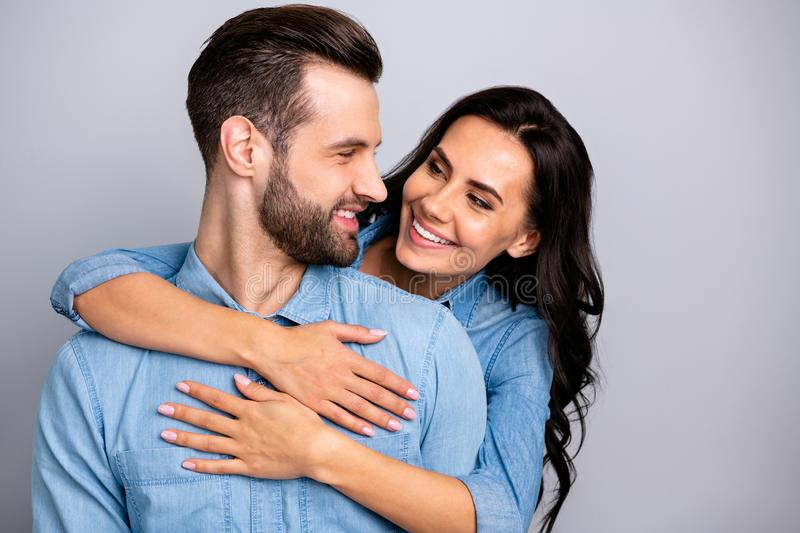 Portrait of charming handsome young sweethearts crazy in love enjoying peaceful gentle beloved isolated wearing blue royalty free stock images