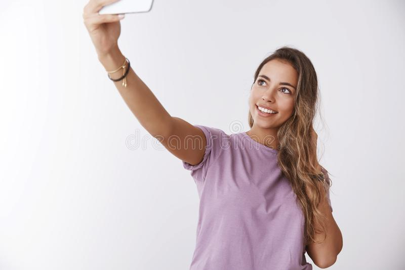 Portrait charming happy girl traveller sightseeing taking selfie smiling posing white background extend hand capture royalty free stock photos