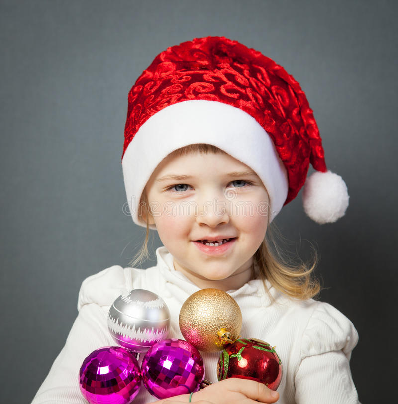 Portrait of a charming little girl in Santa's hat royalty free stock image