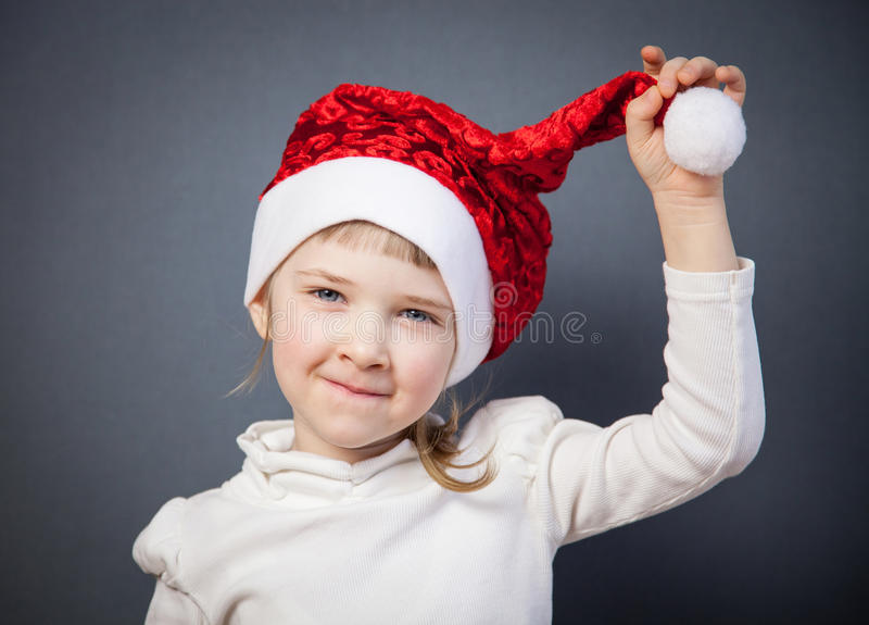 Portrait of a charming little girl in Santa's hat stock photo